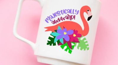 Make flamingo stickers, shirts, beach bags mugs and more with 14 free flamingo cut files! The majestically awkward SVG is so cute! Perfect for summer crafting with your Cricut, Silhouette or other electronic cutting machine! So fun for DIY party favors for tropical themed parties!